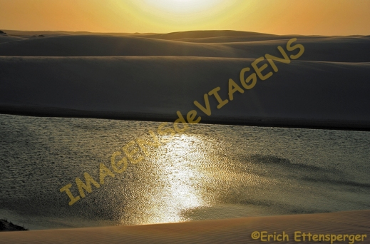 Dunas, lagoa, por do sol